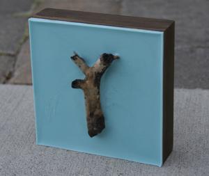 Lisa Marie Sipe light blue encaustic and burned tree branch painting