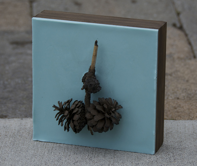 Lisa Marie Sipe light blue encaustic and burned pine cones painting